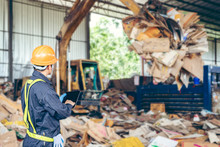 Engineer Standing To Work With Tablet Machines In The Recycling Industry