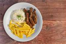 Sliced Steak With Rice And Fri...