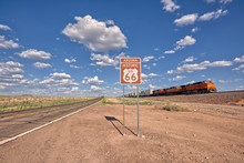 Train Driving Past A Historic Route 66 Sign Near Seligman, Arizona, United States
