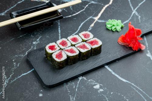 Fototapeta roll with tuna maki on dark marble table obraz