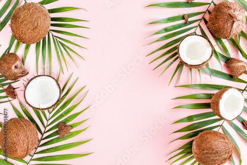 Foto auf Leinwand Palms Pattern with coconuts and tropical palm leaves on pink background. Tropical abstract background. Flat lay, top view.
