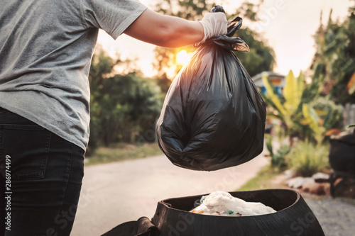 woman hand holding garbage bag for recycle cleaning Canvas Print