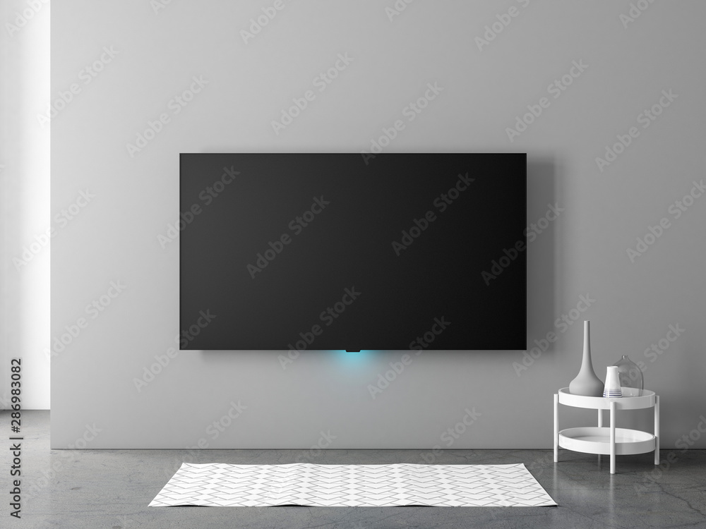 Fototapeta Smart Tv mockup hanging on the gray wall in living room with carpet