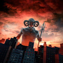 Demon And The City / 3D Illustration Of Horned Devil With Trident Rising Above City Buildings At Dawn