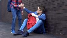 Kind Teenage Student Giving He...