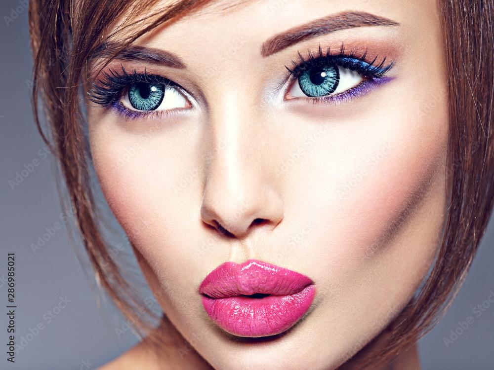 Fototapeta Emotional  young woman with beautiful big blue eyes.