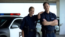 Two Patrol Officers Smiling To...