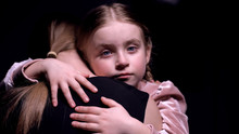 Little Girl Looking Into Camera And Hugging Mother, Long Separation, Close-up