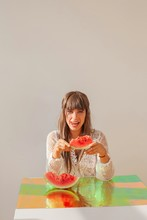 Woman Licking Her Lips And Holding A Slice Of Watermelon