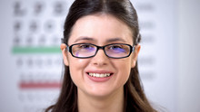 Happy Female Patient Smiling At Camera In New Eyeglasses, Vision Problems