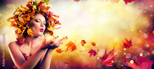 Foto auf Gartenposter Friseur Fall Incoming - Model Woman Blowing Red Magic Leaves - Make a Wish