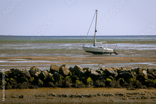 Fotografia The Wadden Sea, with its fascinating interplay of high and low tide or in other