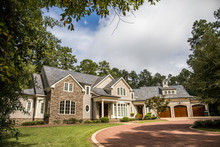 Front View Of Large Estate Hom...
