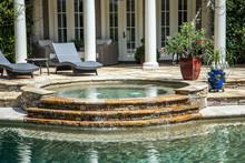 Custom Pool House Behind A Lan...