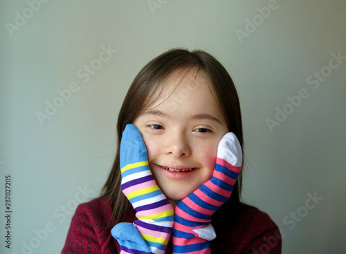 Obraz na plátně  Beautiful girl smiling with socks