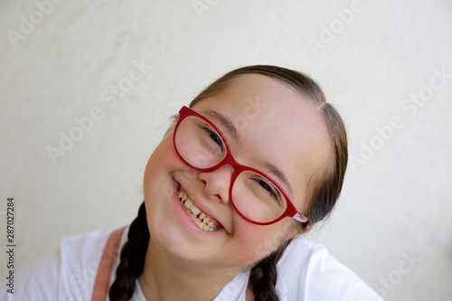 Fotografie, Obraz  Portrait of little girl smiling on background of the wall