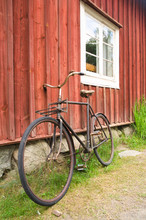 Old Bicycle Leaning Against Wo...
