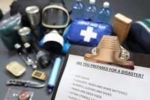 Are You Prepared For A Disaster?Clipboard Checklist.Survival Kit Would Include Food,water,lighting,shelter,and First Aid Kit