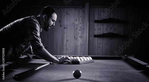 Slika na platnu A man with a beard plays a big billiard