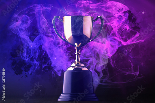 Photographie Trophy on smoke on dark blue futuristic background for e-sport winner concept