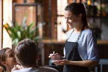 Smiling Female Waitress Take O...