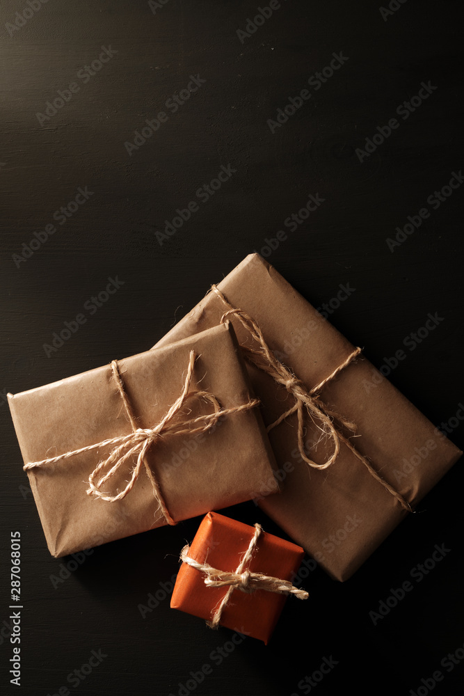 Fototapety, obrazy: Kraft paper gift packages with black background