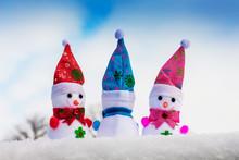 Three Toy Snowmen In The Snow....