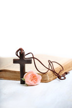 Christian Cross. Wooden Cross, Rose Flower And Bible Book. Concept Of Religion, Faith In God, Church Holiday. Copy Space. Soft Focus