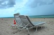 Beach chairs at south beach miami as the first storm clouds of hurricane Dorian hangs in the sky