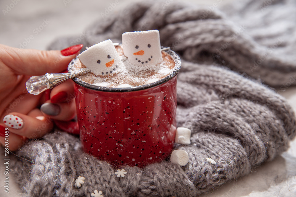 Fototapety, obrazy: Red mug with hot chocolate with melted marshmallow snowman in a woman hands