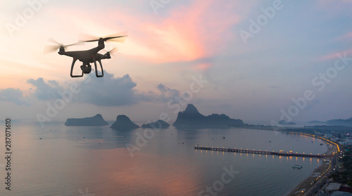 Drone quad copter with high resolution digital camera on the sky mountain and sea side background Wallpaper Mural