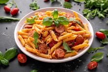 Sausage Penne Pasta With Tomato Sauce And Fresh Herbs