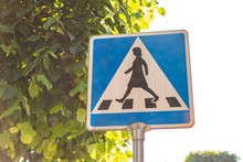 Blue And White Crosswalk Sign With Women In Sweden. Summer Day