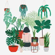 Girl Caring For Plants. Greenh...