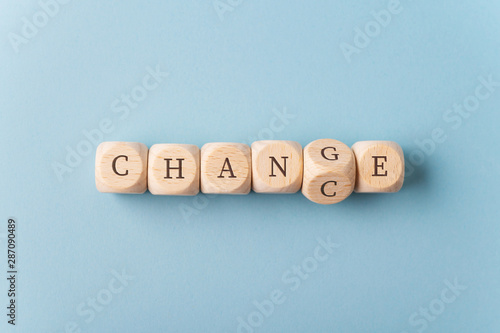 Photo Word Change changing in to Chance spelled on wooden dices