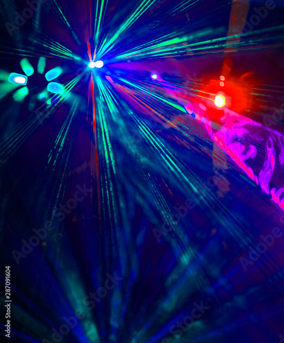 Lighting disco with bright beams of searchlight, laser show. - 287091604