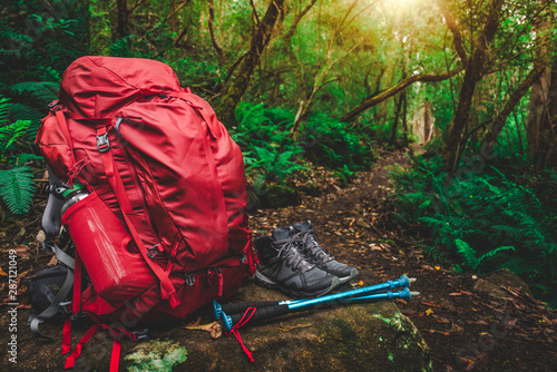 Canvastavla Red backpack and hiking gear set placed on rock in rainforest of Tasmania, Australia