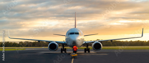 Sunset view of airplane on airport runway under dramatic sky in Hobart,Tasmania, Australia Canvas-taulu