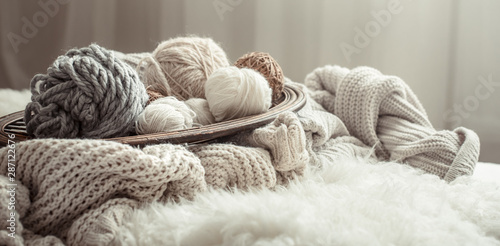Obraz Still life with a cozy variety of yarn for knitting. - fototapety do salonu