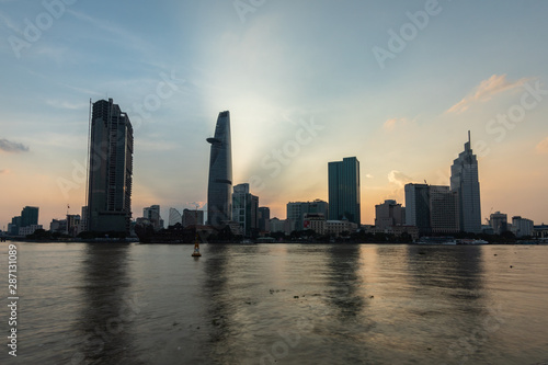 Foto op Aluminium Shanghai skyline view from the river. Vietnamese City with modern building, high rise Relection on water of Asiatic Metropolis of Saigon know also as Ho Chi Minh city, South Vietnam.