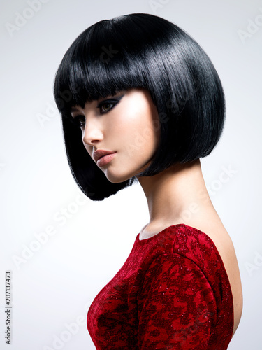Fotomural Beautiful young woman with bob hairstyle.