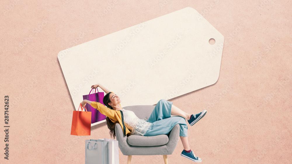 Fototapeta Cheerful shopaholic woman with shopping bags