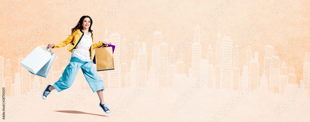Fototapeta Cheerful girl shopping and walking in the city