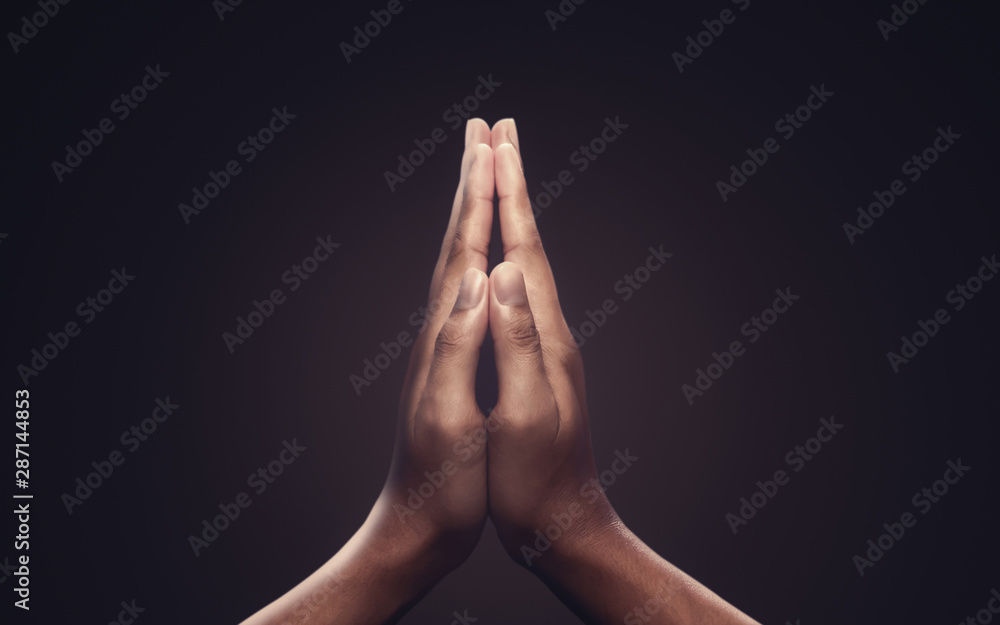 Fototapety, obrazy: Praying hands with faith in religion and belief in God on dark background. Power of hope or love and devotion. Namaste or Namaskar hands gesture.