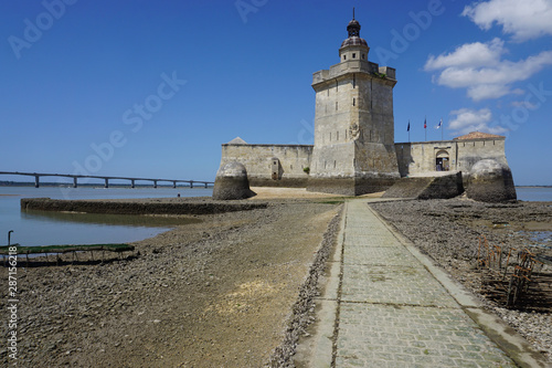 Fortification old stone fortress accessible only at low tide on the west coast of France with the Oléron bridge