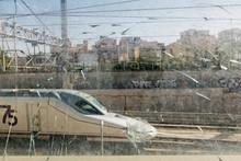 High Speed Train Seen From A Broken Glass
