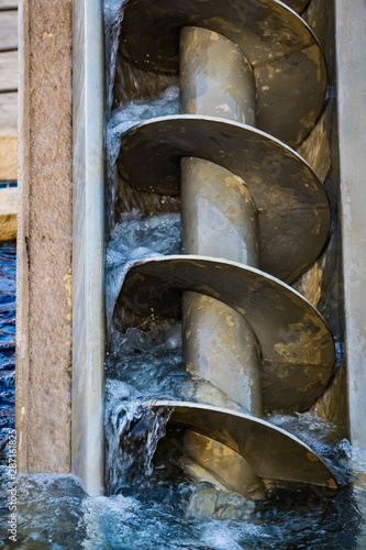 The Archimedes screw, Archimedean screw or screwpump, is a machine historically used for transferring water from a low-lying body of water into irrigation ditches Canvas Print