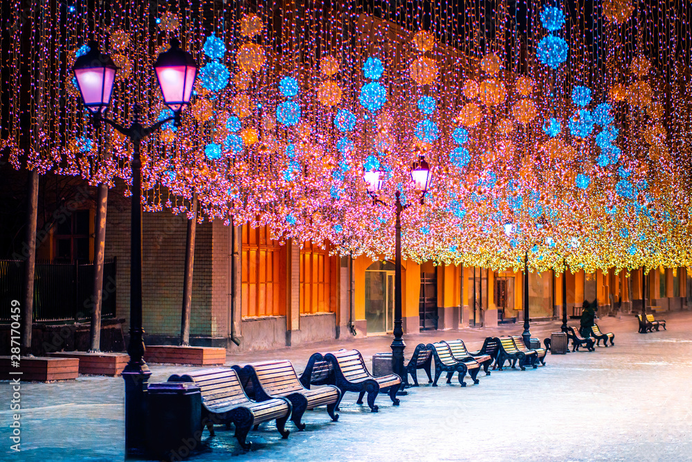 Fototapety, obrazy: Russia. Moscow. Moscow streets are decorated for the new year. Christmas holidays in Russia. New Year. Winter pedestrian road. Christmas garlands of pedestrian streets. Traveling in Moscow at night.