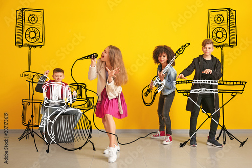 Teenage musicians with drawing instruments playing against color wall - 287173619