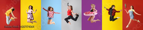 Fotografie, Obraz  Different jumping women on color background